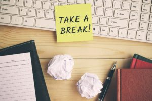 Take a break text on yellow adhesive paper