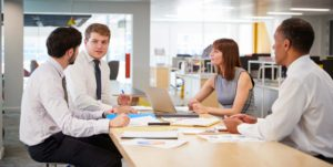 business-colleagues-brainstorming-in-an-open-plan